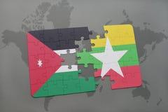imbarazzi con la bandiera nazionale del Giordano e di myanmar su un fondo della mappa di mondo Fotografie Stock Libere da Diritti
