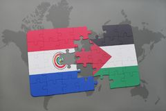 imbarazzi con la bandiera nazionale del Paraguay e della Palestina su una mappa di mondo Immagine Stock