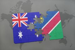 imbarazzi con la bandiera nazionale dell'Australia e della Namibia su un fondo della mappa di mondo Immagini Stock