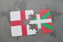 imbarazzi con la bandiera nazionale dell'Inghilterra e del paese basco su un fondo della mappa di mondo Fotografie Stock Libere da Diritti