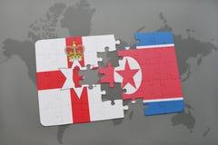 imbarazzi con la bandiera nazionale dell'Irlanda del Nord e del Nord Corea su una mappa di mondo Fotografia Stock