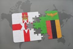imbarazzi con la bandiera nazionale dell'Irlanda del Nord e dello Zambia su una mappa di mondo Fotografia Stock Libera da Diritti