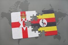imbarazzi con la bandiera nazionale dell'Irlanda del Nord e dell'Uganda su una mappa di mondo Fotografia Stock