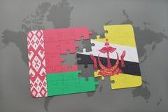 imbarazzi con la bandiera nazionale della Bielorussia e del Brunei su una mappa di mondo Fotografia Stock Libera da Diritti