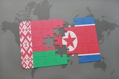 imbarazzi con la bandiera nazionale della Bielorussia e del Nord Corea su una mappa di mondo Immagini Stock Libere da Diritti