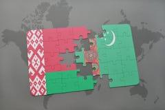 imbarazzi con la bandiera nazionale della Bielorussia e del Turkmenistan su una mappa di mondo Fotografia Stock