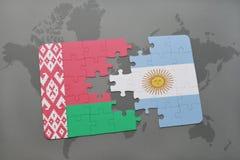 imbarazzi con la bandiera nazionale della Bielorussia e dell'argentina su una mappa di mondo Fotografie Stock