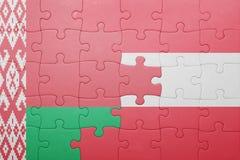 imbarazzi con la bandiera nazionale della Bielorussia e dell'Austria Fotografie Stock Libere da Diritti