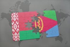 imbarazzi con la bandiera nazionale della Bielorussia e dell'Eritrea su una mappa di mondo Fotografia Stock Libera da Diritti