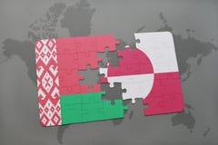 imbarazzi con la bandiera nazionale della Bielorussia e della Groenlandia su una mappa di mondo Immagini Stock