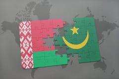 imbarazzi con la bandiera nazionale della Bielorussia e della Mauritania su una mappa di mondo Fotografia Stock Libera da Diritti
