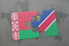 imbarazzi con la bandiera nazionale della Bielorussia e della Namibia su una mappa di mondo Fotografia Stock
