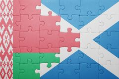 imbarazzi con la bandiera nazionale della Bielorussia e della Scozia Fotografia Stock Libera da Diritti
