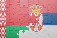 Imbarazzi con la bandiera nazionale della Bielorussia e della Serbia Concetto Fotografia Stock