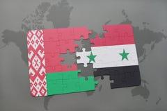 imbarazzi con la bandiera nazionale della Bielorussia e della Siria su una mappa di mondo Fotografia Stock