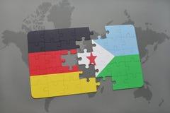 imbarazzi con la bandiera nazionale della Germania e di Djibouti su un fondo della mappa di mondo Fotografia Stock