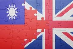 Imbarazzi con la bandiera nazionale della Gran Bretagna e di Taiwan Fotografia Stock