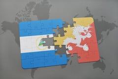 imbarazzi con la bandiera nazionale della Nicaragua e del Bhutan su una mappa di mondo Fotografia Stock