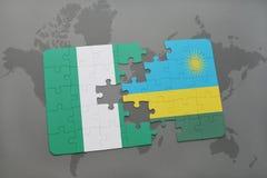 imbarazzi con la bandiera nazionale della Nigeria e della Ruanda su una mappa di mondo Immagine Stock