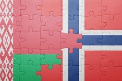 imbarazzi con la bandiera nazionale della Norvegia e della Bielorussia Immagini Stock