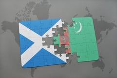 imbarazzi con la bandiera nazionale della Scozia e del Turkmenistan su una mappa di mondo Immagine Stock Libera da Diritti