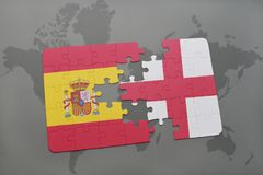 imbarazzi con la bandiera nazionale della spagna e dell'Inghilterra su un fondo della mappa di mondo Fotografia Stock