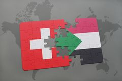 imbarazzi con la bandiera nazionale della Svizzera e del Sudan su un fondo della mappa di mondo Fotografia Stock