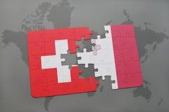 imbarazzi con la bandiera nazionale della Svizzera e di Malta su un fondo della mappa di mondo Fotografia Stock