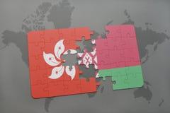 imbarazzi con la bandiera nazionale di Hong Kong e della Bielorussia su un fondo della mappa di mondo Immagini Stock