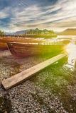 Imbarcazioni a remi agli atterraggi della barca di Keswick con le distorsioni della lente del chiarore di Sun Fotografia Stock Libera da Diritti