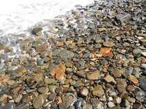 Imbros pebbles on the beach, turkish name gokceada Royalty Free Stock Photography