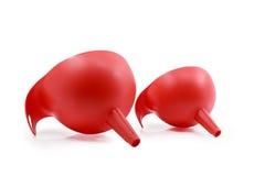 Imbuto di plastica rosso su fondo bianco Immagine Stock