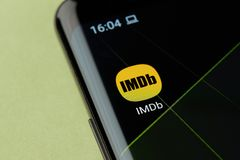 IMDb movie rating app icon. New york, USA - April 22, 2019: IMDb movie rating app icon macro view on smartphone screen desktop royalty free stock photography