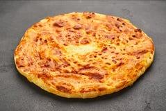 Imeretian Imeruli khachapuri - traditional Georgian cheese pastry. Homemade baking stock photos