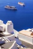 Imerovigli village architecture overlooking the cruise ships in the caldera, Santorini island Royalty Free Stock Photos