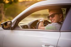 IMG_3715.jpg. Portrait of young cheerful male in car Royalty Free Stock Photography