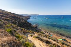 Imgiebah Bay selmun malta. Beautiful azure blue water of Selmun beach in the summer time, in Maltese Imgiebah Bay, Il-Mellieha, Malta, June 2017 Stock Photo