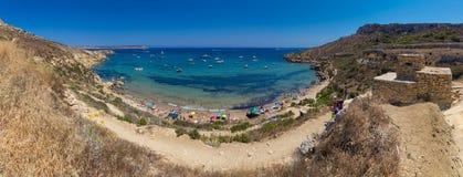 Imgiebah Bay selmun malta. Ultra high resolution panorama of beautiful azure blue water of Selmun beach in the summer time, in Maltese Imgiebah Bay, Il-Mellieha Royalty Free Stock Photos