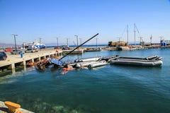 Imigrantes de Inflatables no porto Imagem de Stock