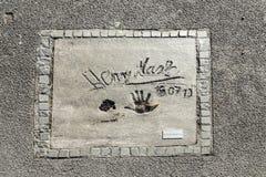 Imiona i ręka druki gwiazdy przy Monachium spacerem sława w Zdjęcia Stock
