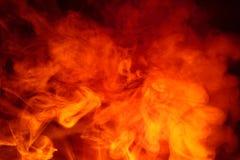 Imitatie van heldere flitsen van oranjerode vlam Achtergrond van samenvatting gekleurde rook stock foto