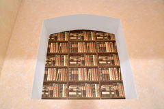 Imitation of a book rack in a niche. Interior fragment Royalty Free Stock Photos