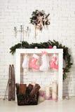 Imitation of christmas firewood with socks Stock Images