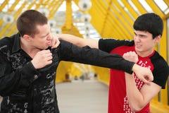 Imitation of fight. On footbridge royalty free stock photos