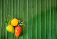 Imitation Fruits (Kanom Look Choup) Thai dessert on banana leaf Royalty Free Stock Photography