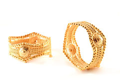Imitation Jewellery. Some shiny bracelets made in golden metals. imitation jewellery.Fake gold Royalty Free Stock Photo