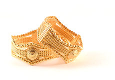 Imitation Jewellery. Some shiny bracelets made in golden metals. imitation jewellery.Fake gold Stock Photos