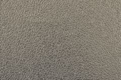 Imitation of leather dark beige color Stock Images