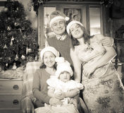 Imitation of  retro photo of happy family. Imitation of  retro photo of happy married couple with child visiting mom for Christmas Stock Photography