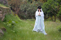 A imitation showing chinese girl. A chinese girl who dressed in ancient costume of China was imitation showing the goddess of mercy in garden Royalty Free Stock Image